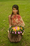 Pretty woman in Thai style clothes in posing hold flower joist. Stock Photos