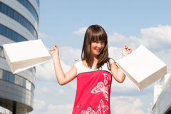 Pretty woman with their purchases Royalty Free Stock Photos