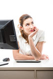 Pretty woman thinking in her office Royalty Free Stock Photos