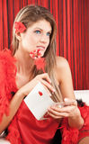 Pretty woman thinking what to write. On a Valentine card Royalty Free Stock Photography