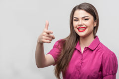 Pretty woman is threatening to shoot someone Royalty Free Stock Photo