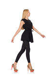 Pretty woman in tight black pants isolated on Stock Photography