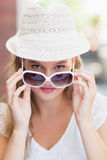 Pretty woman tilting her sunglasses Stock Photo