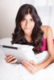 Pretty Woman on touch Pad Stock Image