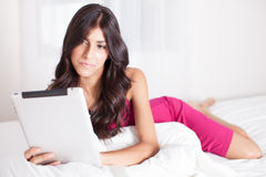 Pretty Woman on touch Pad Stock Photography