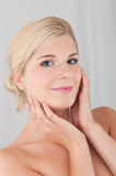 Pretty woman touching pure healthy skin Stock Photography