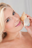 Pretty woman touching pure healthy skin Royalty Free Stock Photo