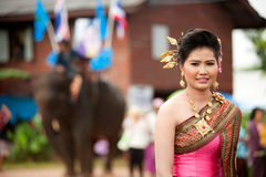 Pretty woman in traditional dress in Ordination parade. Royalty Free Stock Photos