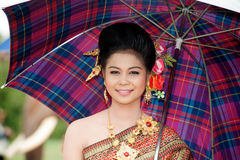 Pretty woman in traditional dress in Ordination parade. Stock Photo
