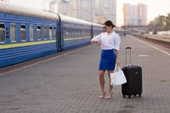 Pretty woman at the train station. Pretty business woman waiting at the train station stock photography