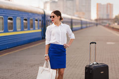 Pretty woman at the train station. Pretty business woman waiting at the train station royalty free stock photography