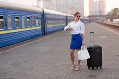 Pretty woman at the train station. Pretty business woman waiting at the train station stock photos