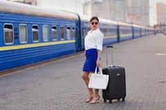 Pretty woman at the train station. Pretty business woman waiting at the train station royalty free stock photo