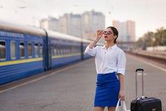 Pretty woman at the train station. Pretty business woman waiting at the train station stock image