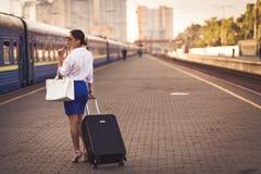 Pretty woman at the train station. Pretty business woman waiting at the train station stock images