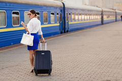 Pretty woman at the train station. Pretty business woman waiting at the train station royalty free stock images