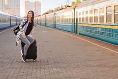 Pretty woman at the train station. Pretty woman waiting at the train station royalty free stock photography