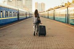 Pretty woman at the train station. Pretty woman waiting at the train station stock images