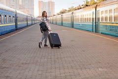 Pretty woman at the train station. Pretty woman waiting at the train station royalty free stock photo