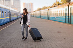 Pretty woman at the train station Royalty Free Stock Photo