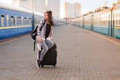 Pretty woman at the train station. Pretty woman waiting at the train station stock photo
