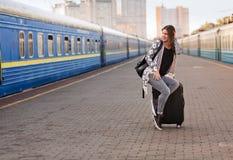 Pretty woman at the train station. Pretty woman waiting at the train station stock photography