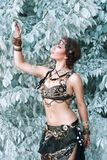 Pretty woman in tribal fusion costume near the beautiful white f Royalty Free Stock Image