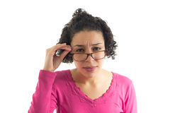 Pretty woman tries to read over her glasses. eyesight test chart Stock Photos