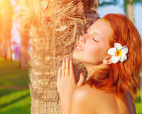 Pretty woman on tropical resort Royalty Free Stock Photography
