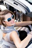 Pretty woman turns backin the car Royalty Free Stock Photos