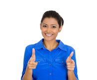 Pretty woman with two hands guns sign gesture pointing at you. Closeup portrait of young pretty woman with two hands guns sign gesture pointing at you, isolated Royalty Free Stock Image