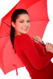 Pretty Woman With Umbrella. Attractive young woman posing with umbrella on white background royalty free stock images