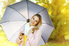 Pretty woman with umbrella in autumn day Stock Photos