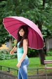 Pretty Woman Under Big Umbrella In The Park Royalty Free Stock Photo