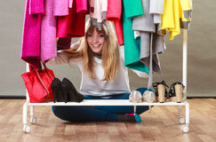 Pretty woman under clothes. Royalty Free Stock Photo
