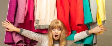 Pretty woman under clothes. Stock Photos