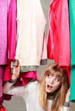 Pretty woman under clothes. Royalty Free Stock Images