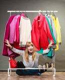 Pretty woman under clothes. Stock Images