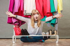 Pretty woman under clothes. Stock Image