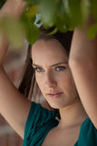 Pretty woman under leaves Royalty Free Stock Image