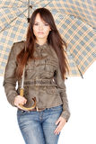 Pretty woman under umbrella Stock Photography