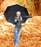 Pretty woman under umbrella Stock Photo