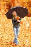 Pretty woman under umbrella stock photo