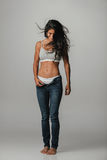 Pretty woman with unzipped pants and hair blowing Stock Photos