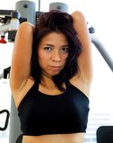 Pretty woman uses an exercise machine Stock Photo