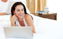 Pretty woman using her laptop Royalty Free Stock Photos