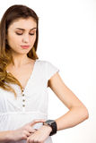 Pretty woman using her smart watch. On white background Stock Photography