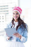 Pretty woman using her tablet pc Stock Images