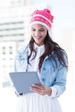Pretty woman using her tablet pc Royalty Free Stock Image
