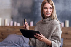 Pretty woman using laptop and credit card Royalty Free Stock Photo